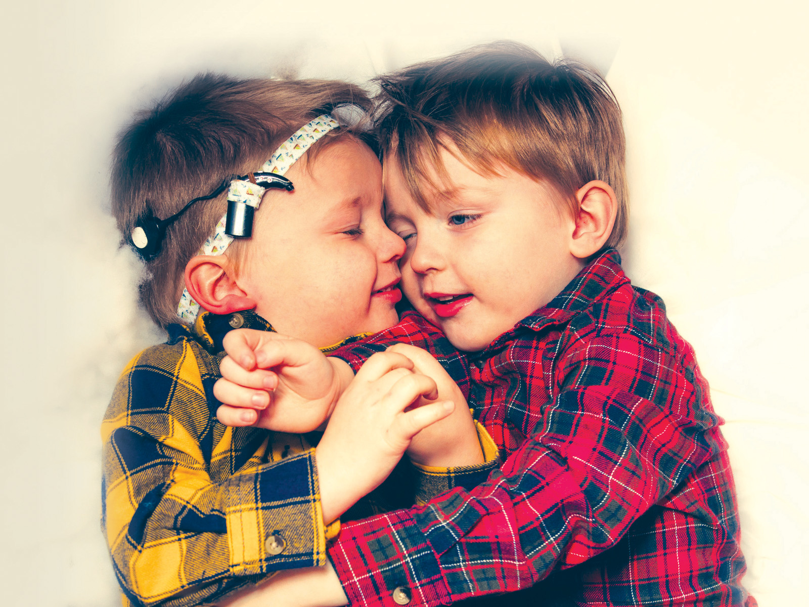 Two young brothers hugging each other