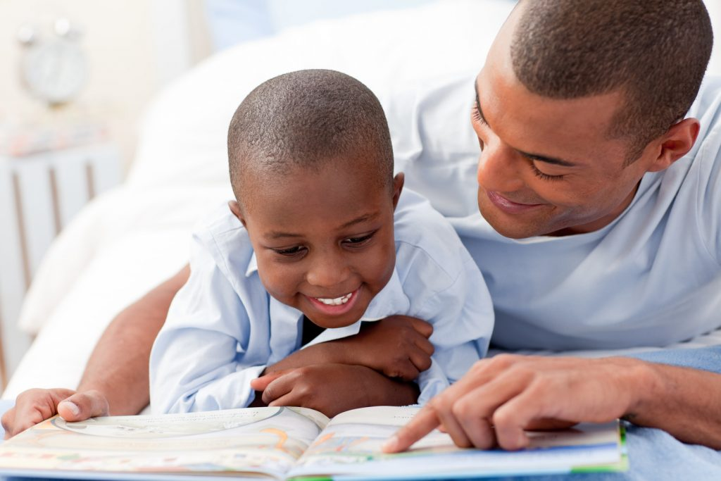 father teaching son to read