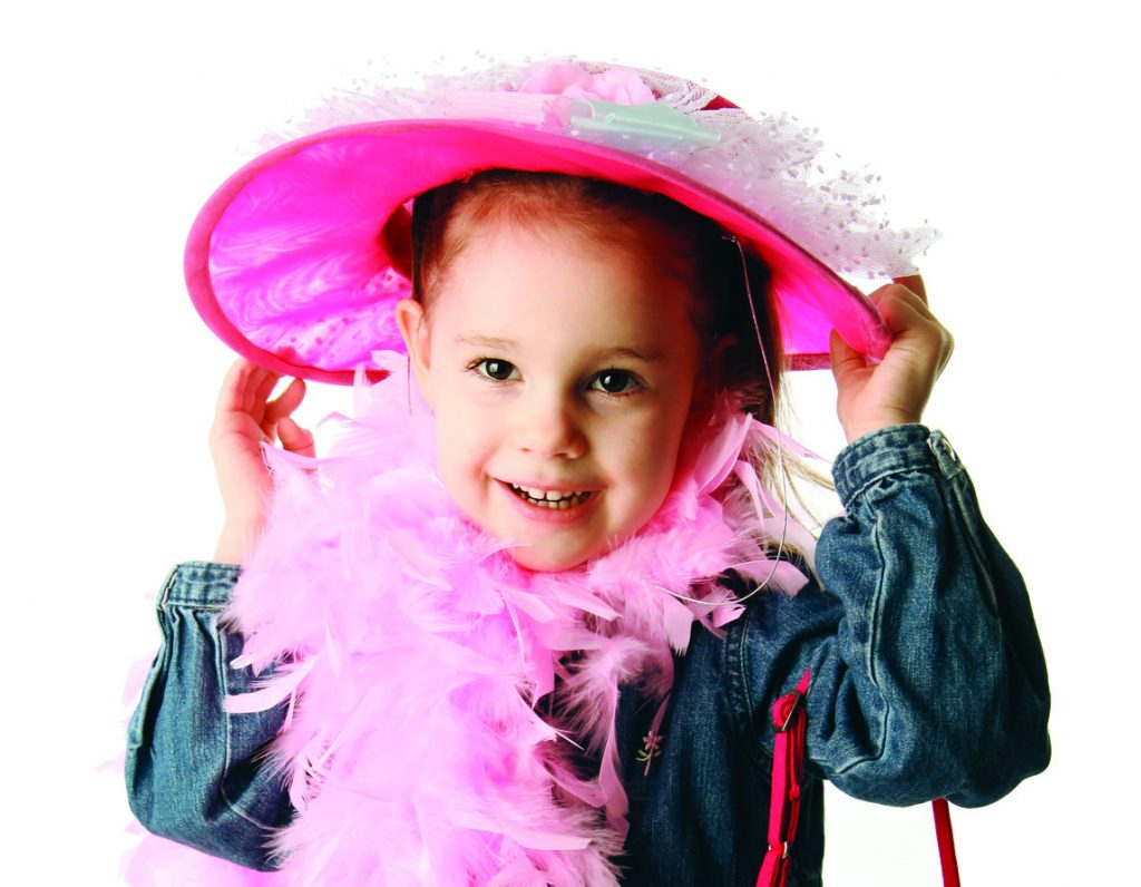 small girl in pink hat and boa