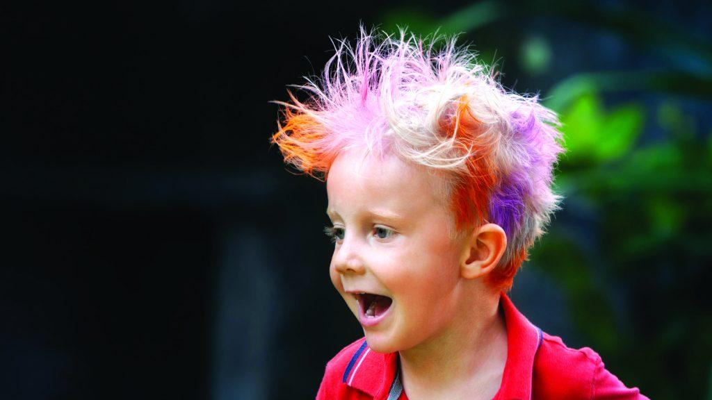 young boy with rainbow coloured hair